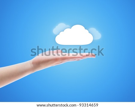 Woman hand share the cloud against blue background. Concept image on cloud computing theme with copy space. - stock photo