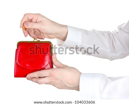 woman hand throwing coin in purse isolated on white