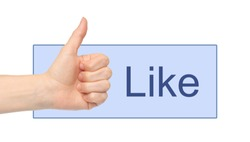Woman hand thumb up with like word in blue rectangle on white background