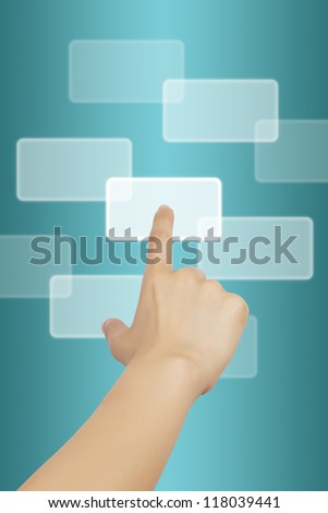Woman hand touching button on blue background.