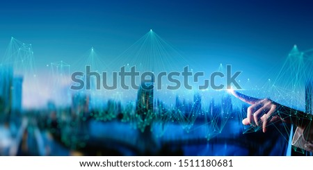 Woman hand touching Wireless network and Connection technology elements covering on Abstract building city.