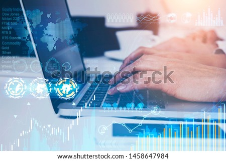 Woman hand typing on laptop in office with double exposure of business infographics interface. Stock market and future technology concept. Toned image. Elements of this image furnished by NASA #1458647984