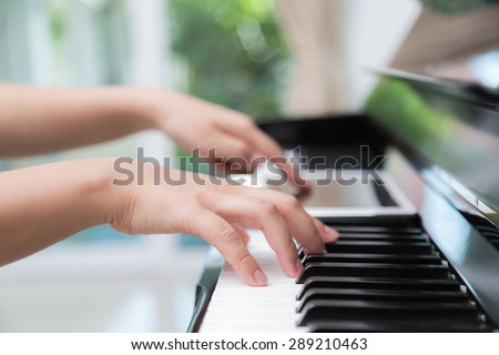Woman hand use tablet and  playing piano music
