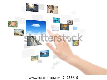 Woman hand using touch screen interface with pictures in frames. Isolated on white.