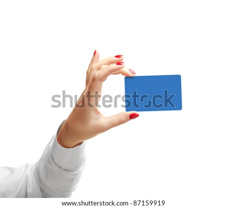 Woman hand with a credit card. Isolated on white. Closeup.