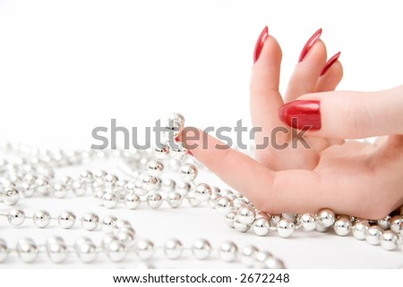 Woman hand with beads. On white.