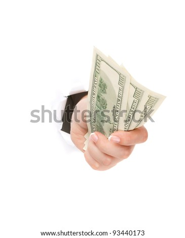 Woman hand with dollars through a hole in paper isolated on white background