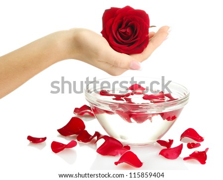 woman hand with glass bowl of water with petals, isolated on white