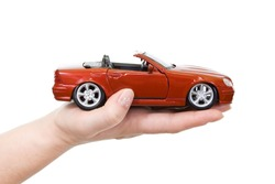 Woman hand with holding red sports car - isolated