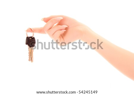 Woman hand with keys isolated on white