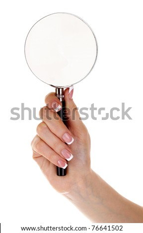 Woman hand with magnifier - stock photo