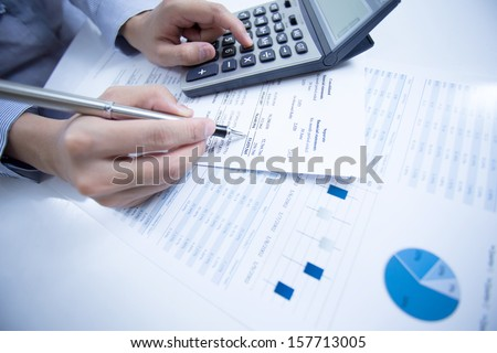 woman hand with pen and business report