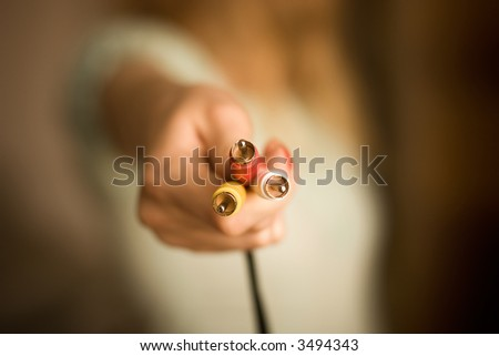 Woman hand with plugs. Low DOF. - stock photo
