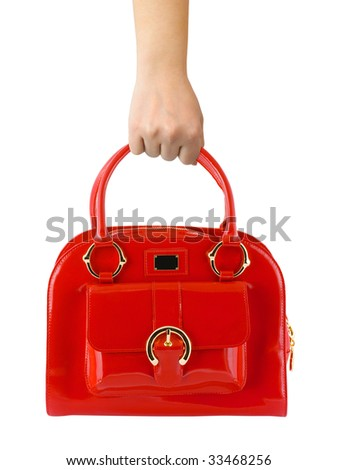 Woman hand with red bag isolated on white background