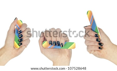 woman hand with stamped manicured nails holding nail file