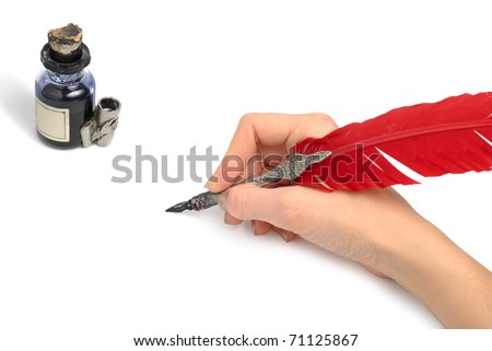 Woman hand with style antique quill writing near glass inkwell isolated over white background. Both clipping paths included.