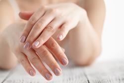 woman hands applying moisturizing cream to her skin