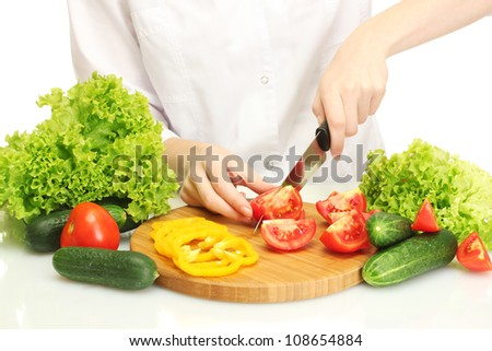 woman hands cutting vegetables on kitchen blackboard