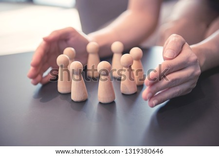 Woman hands defending his team with a gesture of protection, Security and safety in a business team. Foto stock ©
