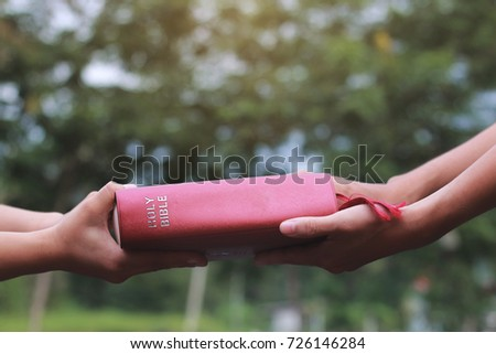Woman hands giving Bible and evangelizing someone,Gospel  Stock photo ©