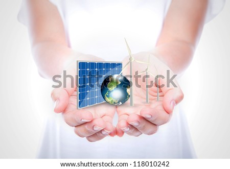 Woman hands hold Alternative Energy (solar cell, earth, wind turbine ) Elements of this image furnished by NASA
