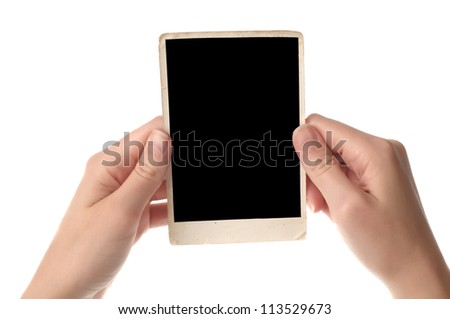 Woman hands holding an old photo