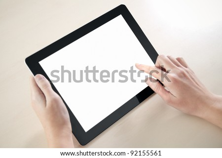 Woman hands holding and pointing on contemporary digital frame with blank screen.