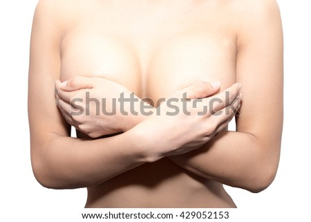 Woman hands holding breast