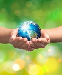 Woman hands holding earth. Save the earth concept. Earth image courtesy of NASA.