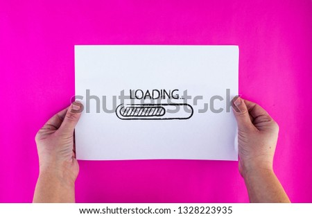 woman hands holds drawn loading bar on paper sheet #1328223935