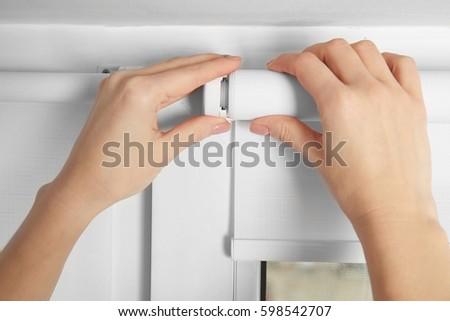 Woman hands installing window blinds, closeup #598542707