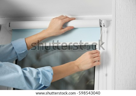 Woman hands installing window blinds, closeup #598543040