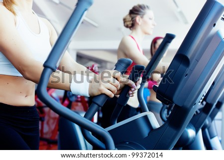 Woman hands on tracking machine in fitness center