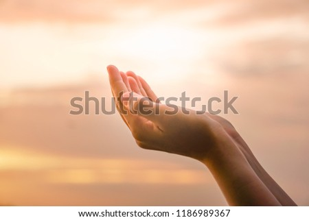 Woman hands place together like praying in front of nature ocean and blue sky  background. #1186989367