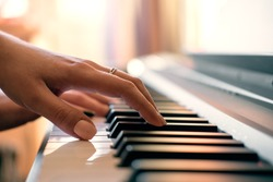 woman hands playing the piano