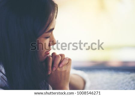 woman hands praying to god with the bible. Woman Pray for god blessing to wishing have a better life. begging for forgiveness and believe in goodness. Christian life crisis prayer to god. - Shutterstock ID 1008546271