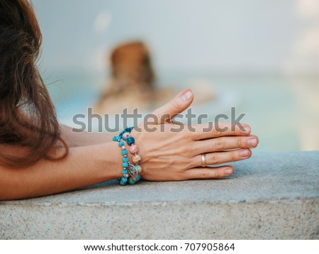 Woman hands together symbolizing prayer and gratitude. Mudra. Yoga concept. #707905864