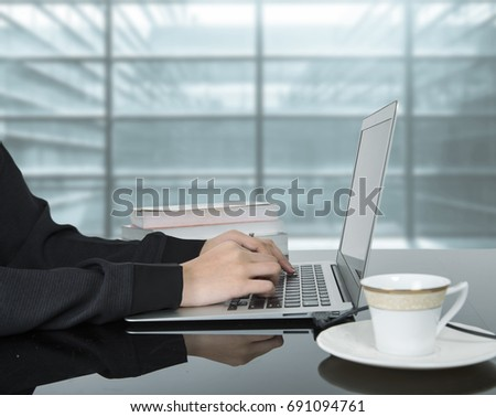 Woman hands typing on laptop keyboard at the office, Woman worker and business concept. #691094761