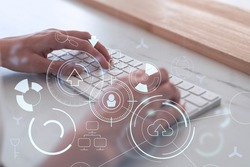 Woman hands typing the keyboard to create innovative software to change the world and provide a completely new service. Close up shot. Hologram tech graphs. Concept of Dev team. Casual wear.