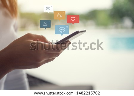 Woman hands using smartphone with icon social media social network and marketing.