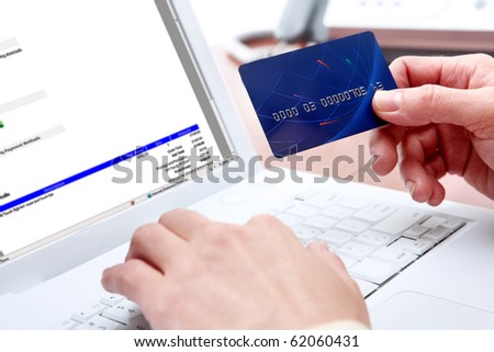 Woman hands, white laptop, credit card, shopping online payment - stock photo