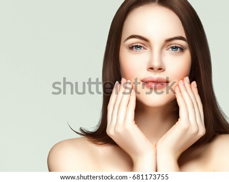 Woman hands with beautiful manicure, woman face beauty portrait, brunette female with healthy skin and hair. #681173755