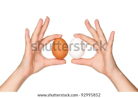 Woman hands with eggs isolated on white background