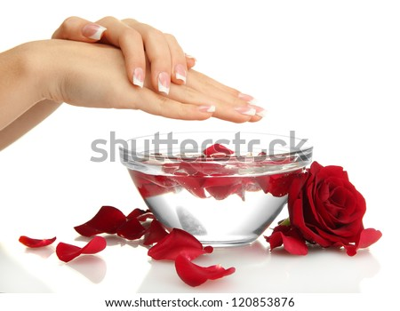 woman hands with glass bowl of water with petals, isolated on white