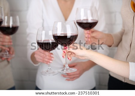 Woman hands with glasses of wine close-up #237510301