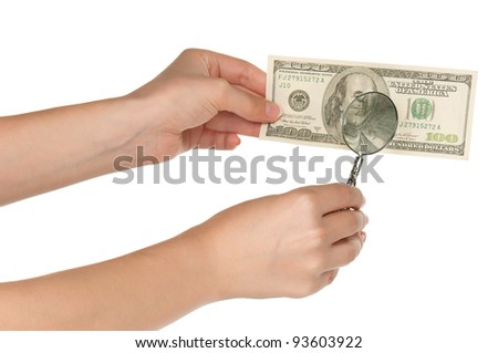 Woman hands with magnifying glass and dollars isolated on white background