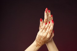 Woman Hands with mehndi