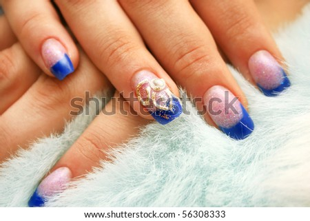 Woman hands with nail art on fur background. - stock photo