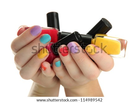 woman hands with nail polishes isolated on white