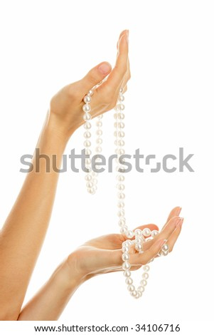 Woman hands with pearl necklace isolated on white background - stock photo